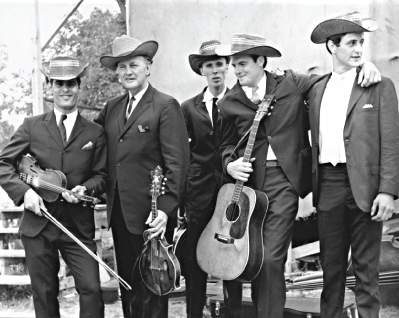 From the Archives: Left to Right: Gene Lowinger, Bill Monroe, Lamar Grier, Peter Rowan and James Monroe. Photo by Ron Petronko.