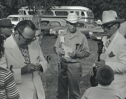 Lester Flatt and Bill Monroe signing autographs in Garland, Texas 1971